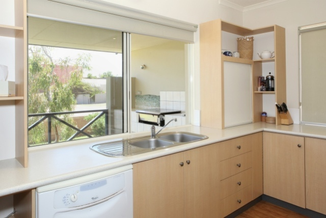Kitchen and outside bbq Rockpool Beach House